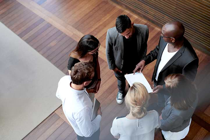 Team standing in circle talking